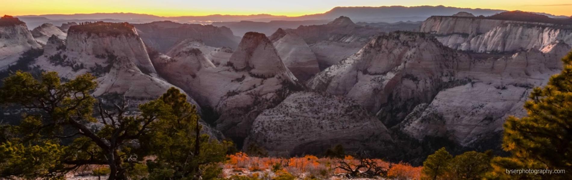 sun setting on mountainous terrain